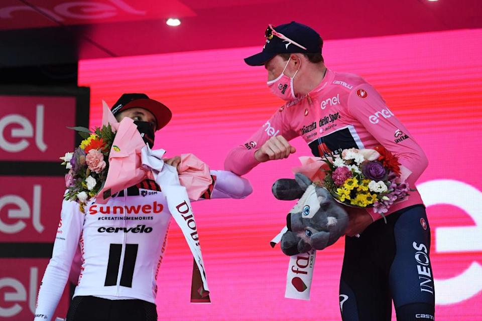 MILANO ITALY  OCTOBER 25 Podium  Jai Hindley of Australia and Team Sunweb  Tao Geoghegan Hart of The United Kingdom and Team INEOS Grenadiers Pink Leader Jersey  Celebration  Social distancing  during the 103rd Giro dItalia 2020 Stage 21 a 157km Individual time trial from Cernusco sul Naviglio to Milano  ITT  girodiitalia  Giro  on October 25 2020 in Milano Italy Photo by Tim de WaeleGetty Images
