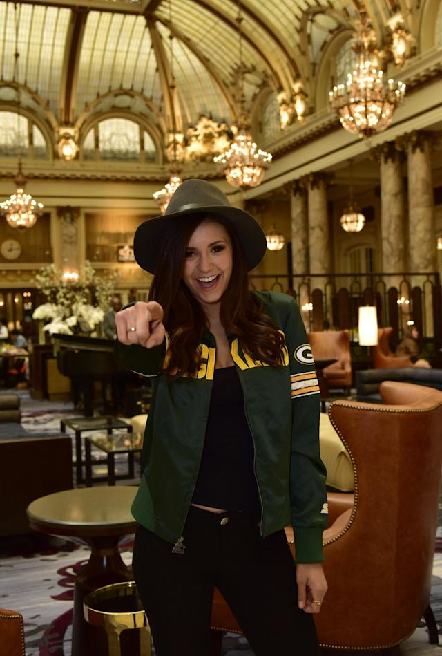 SAN FRANCISCO, CA - FEBRUARY 07: Nina Dobrev wears a starter jacket as she heads to the big game on February 7, 2016 in San Francisco, California. (Photo by Eugene Gologursky/Getty Images for ICONIX)