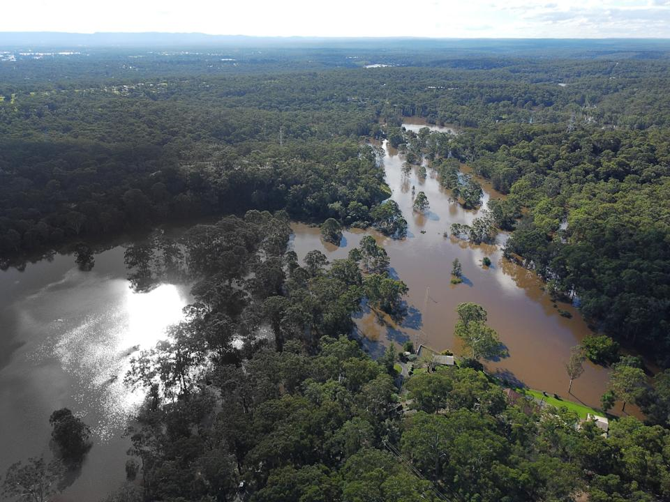 An aerial view of the flooded Cattai Ridge Road at Glenorie.