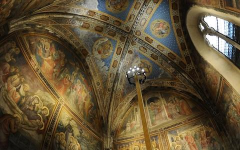A visitor walk in one of the rooms of the Farmacia di Santa Maria Novell - Credit: AFP/GABRIEL BOUYS