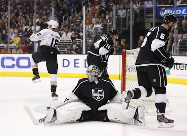 Los Angeles Kings goalie Martin Jones reacts after giving up a goal to Anaheim Ducks right wing Tim Jackman, rear left, as Los Angeles Kings right wing Justin Williams, top center, and Kings defenseman Jake Muzzin , right, skate by during the first period of an NHL hockey game in Los Angeles, Saturday, March 15, 2014. (AP Photo/Danny Moloshok)