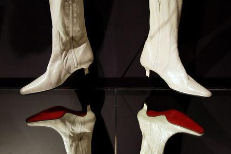 FILE PHOTO: A pair of boots by French designer Christian Louboutin are seen during a media viewing of his retrospective exhibition at the Design Museum in London April 30, 2012. REUTERS/Stefan Wermuth/File Photo