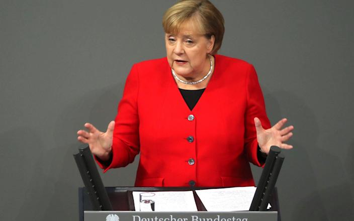 Angela Merkel was speaking in a budget debate in the German parliament - REX