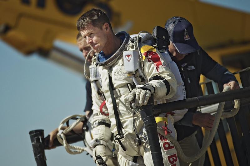 "FILE - This photo provided by Red Bull Stratos shows pilot Felix Baumgartner of Austria reacting after his mission was aborted in Roswell, N.M., on Oct. 9, 2012.  on Sunday, Oct. 14, 2012,  mission control officials declared a ""weather hold"" until 8:15 a.m. MDT, and said that inflation of the balloon wouldn't begin until after that hold is lifted. Earlier, the launch team said they were aiming for the three-hour ascent to begin Sunday at 8 a.m. The jump was postponed twice last week because of high winds. (AP Photo/Red Bull Stratos, Joerg Mitter)"