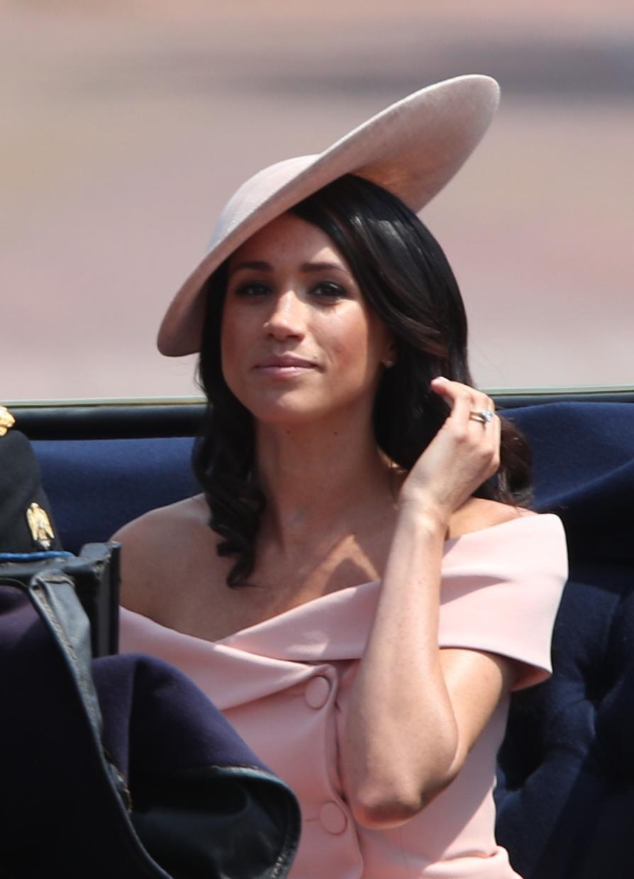 The Duchess of Sussex made her debut at Trooping the Colour in a blush pink off-shoulder Carolina Herrera dress with a matching hat by Philip Treacy. (PA Images)
