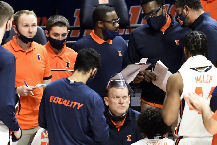 Illinois coach Brad Underwood talks to players during the second half of the team's NCAA college basketball game against Indiana on Saturday, Dec. 26, 2020, in Champaign, Ill. (AP Photo/Holly Hart)
