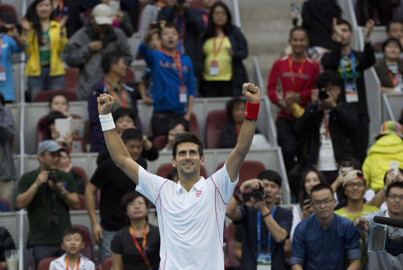 Novak Djokovic of Serbia celebrates after defeated Lukas Rosol of the Czech Republic in the China Open tennis tournament at the National Tennis Stadium in Beijing, China Tuesday, Oct. 1, 2013. (AP Photo/Andy Wong)