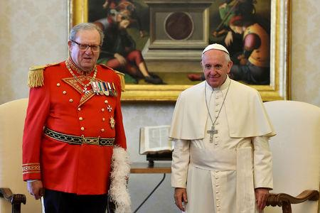 Pope Francis (R) meets Robert Matthew Festing, Prince and Grand Master of the Sovereign Order of Malta during a private audience at the Vatican June 23, 2016.  REUTERS/Gabriel Bouys/Pool/File Photo