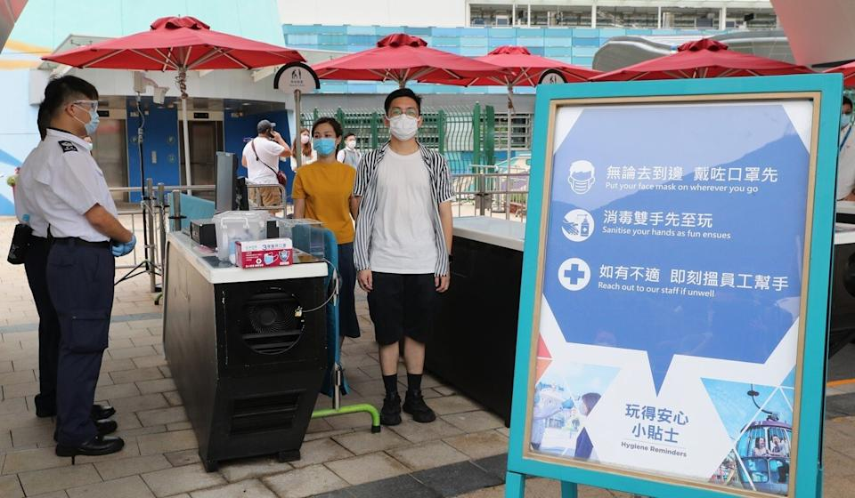 A notice board reminds Ocean Park visitors of measures in place to prevent the spread of Covid-19. Photo: Edmond So