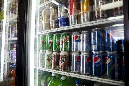 Cans of soda are displayed in a case at Kwik Stops Liquor in San Diego