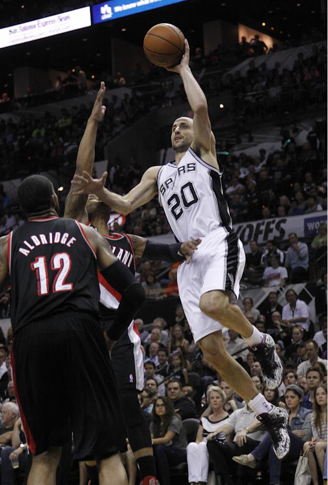 SAN ANTONIO, TX - MAY 8: Manu Ginobili #20 of the San Antonio Spurs shoots over LaMarcus Aldridge #12 of the Portland Trail Blazers in Game Two of the Western Conference Semifinals during the 2014 NBA Playoffs at the AT&T Center on May 8, 2014 in San Antonio, Texas. (Photo by Chris Covatta/Getty Images)