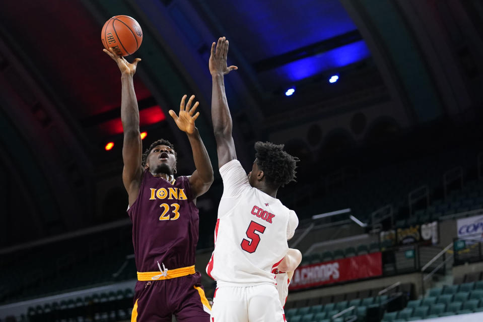 Iona's Nelly Junior Joseph, left, goes up for a shot against Fairfield's Supreme Cook in the first half of an NCAA college basketball game during the finals of the Metro Atlantic Athletic Conference tournament, Saturday, March 13, 2021, in Atlantic City, N.J. (AP Photo/Matt Slocum)