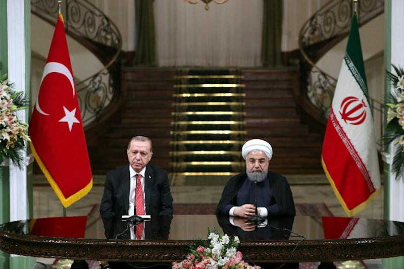 Iran's President Hassan Rouhani (R) and his Turkish counterpart Recep Tayyip Erdogan attend a press conference in Tehran (AFP Photo/HO)