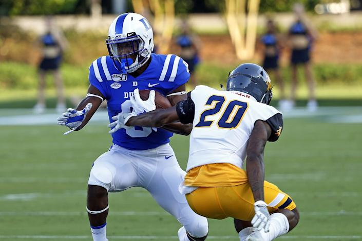 Duke's Brittain Brown (8) pulls away from North Carolina A&T's Najee Reams