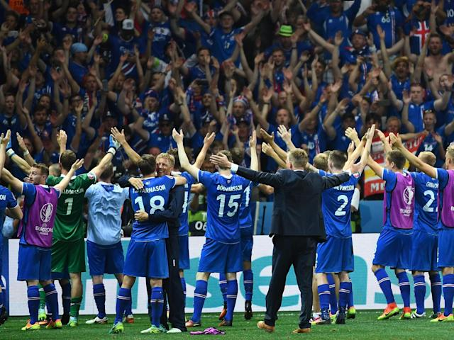 Iceland's players celebrate eliminating England at Euro 2016: Getty