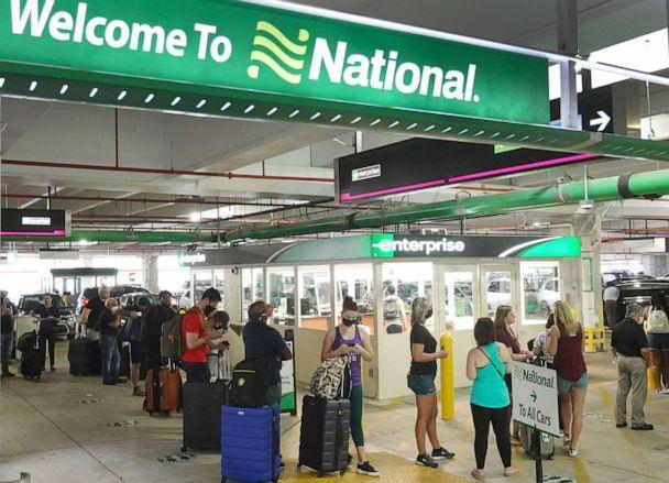 PHOTO: People wait in line at Enterprise car rental agency in the Miami International Airport on April 12, 2021 in Miami. Car rental agencies have limited supply of vehicles as people begin traveling again after being locked down during the pandemic. (Joe Raedle/Getty Images, FILE)