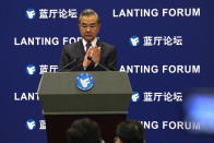Chinese Foreign Minister Wang Yi attends a symposium to mark the 50th anniversary of the People's Republic of China's entry into the U.N. at the Foreign Ministry in Beijing on Friday, June 25, 2021. Foreign Minister Wang Yi said China remains deeply committed to United Nations peacekeeping efforts, where more than 2,400 Chinese troops and police are serving, a contribution that underscores China's increasing prominence in the world body. (AP Photo/Ng Han Guan)