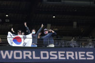 Fans pose before Game 1 of the baseball World Series between the Los Angeles Dodgers and the Tampa Bay Rays Tuesday, Oct. 20, 2020, in Arlington, Texas. (AP Photo/Eric Gay)