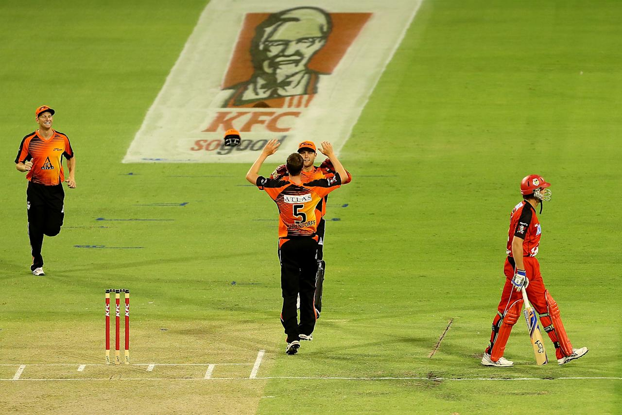 PERTH, AUSTRALIA - DECEMBER 29: Jason Behrendorff and Tom Triffitt of the Scorchers celebrate the wicket of Ben Rohrer of the Renegades during the Big Bash League match between the Perth Scorchers and the Melbourne Renegads at WACA on December 29, 2012 in Perth, Australia.  (Photo by Paul Kane/Getty Images)