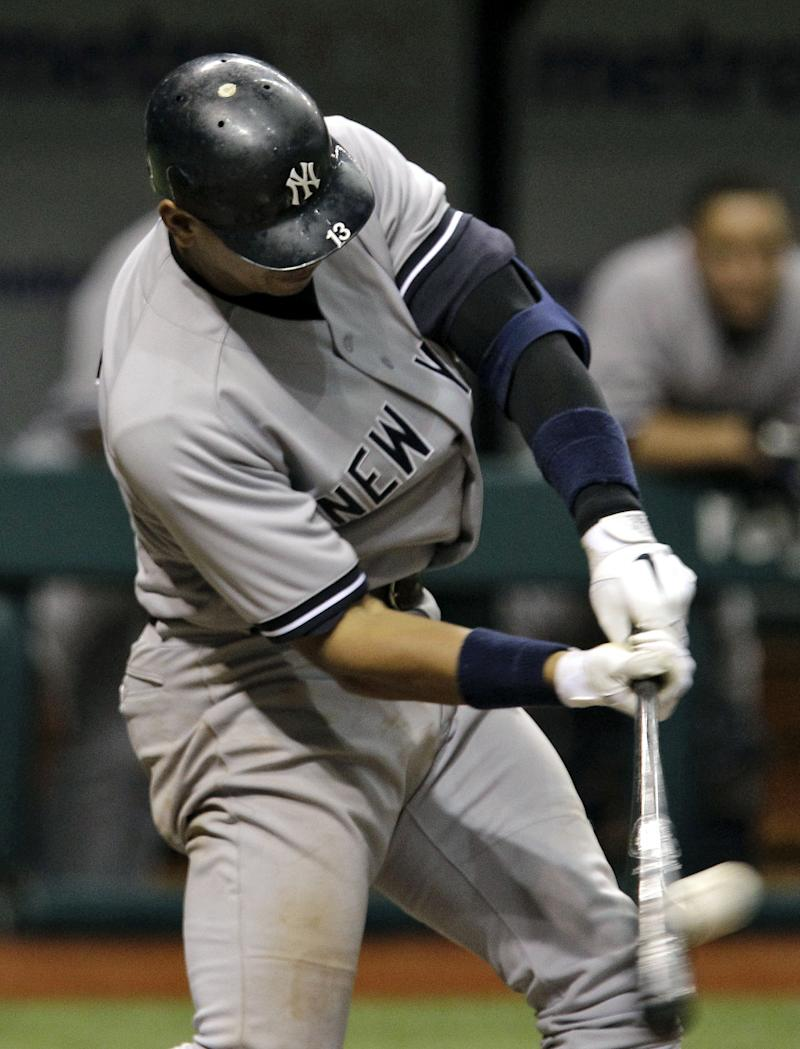 New York Yankees' Alex Rodriguez connects for a sixth-inning home run off Tampa Bay Rays starting pitcher James Shields during an MLB baseball game Tuesday, May 17, 2011 in St. Petersburg, Fla. (AP Photo/Chris O'Meara)