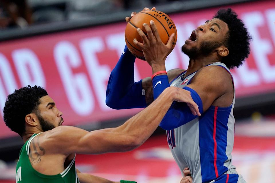 Detroit Pistons guard Saddiq Bey is fouled by Boston Celtics forward Jayson Tatum during the second half Friday, Jan. 1, 2021 at Little Caesars Arena.