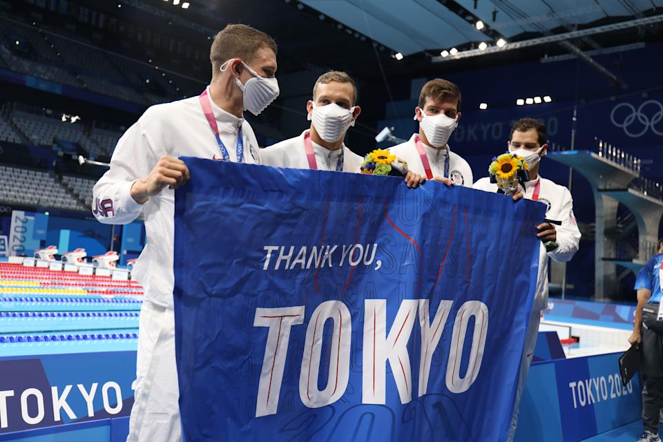 TOKYO, JAPAN - AUGUST 1:  Ryan Murphy, Michael Andrew, Caeleb Dressel and Zach Apple of the United States with a T