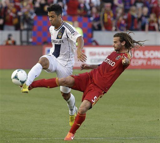 Real Salt Lake midfielder Kyle Beckerman (5) defends against Los Angeles Galaxy forward Charlie Rugg, left, during the first half of an MLS soccer game Saturday, April 27, 2013, Sandy, Utah. (AP Photo/Rick Bowmer)