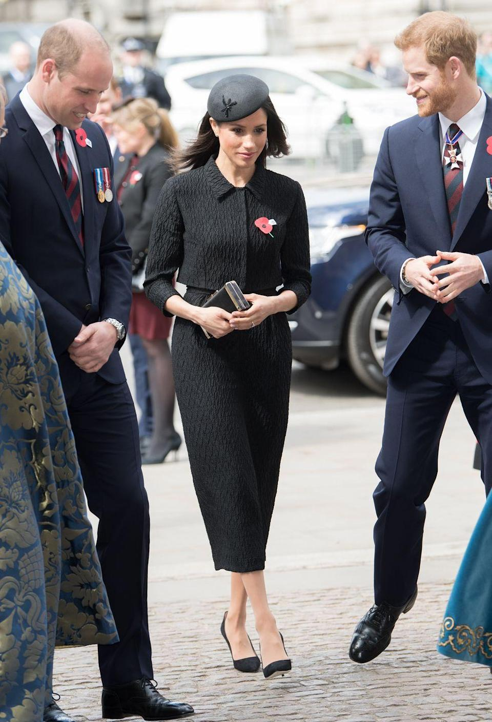 """<p>Markle wore another somber ensemble <a href=""""https://www.townandcountrymag.com/society/tradition/a20060050/prince-william-anzac-day-royal-baby-3-comments/"""" rel=""""nofollow noopener"""" target=""""_blank"""" data-ylk=""""slk:for the Anzac Day service"""" class=""""link rapid-noclick-resp"""">for the Anzac Day service</a> at Westminster Abbey. For this occasion, she wore custom Emilia Wickstead blazer and dress with a Philip Treacy beret, Manolo Blahnik shoes, and a Jimmy Choo clutch. She also wore a poppy pin, which is worn in remembrance of those who died in war. </p>"""