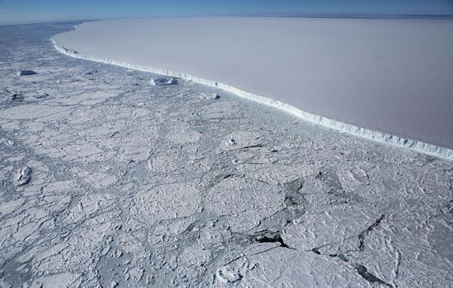 <p>The western edge of the famed iceberg A-68 (top right), calved from the Larsen C ice shelf, is seen from NASA's Operation IceBridge research aircraft, near the coast of the Antarctic Peninsula region, on Oct. 31, 2017, above Antarctica. The massive iceberg was measured at approximately the size of Delaware when it first calved in July. (Photo: Mario Tama/Getty Images) </p>