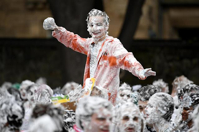 "<p>Students from St Andrews University indulge in a tradition of covering themselves with foam to honor the ""academic family"" on Lower College Lawn on Oct. 23, 2017, in St Andrews, Scotland. (Photo: Jeff J Mitchell/Getty Images) </p>"
