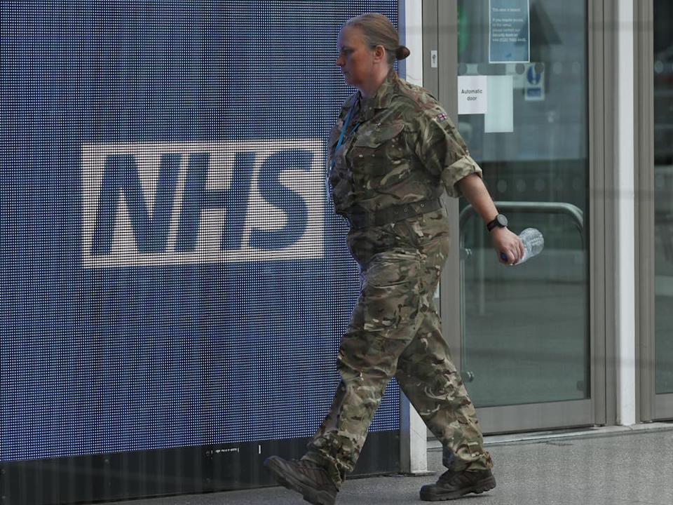 <p>Nearly a quarter of hospital's staff are off sick, says medical director</p> (PA)