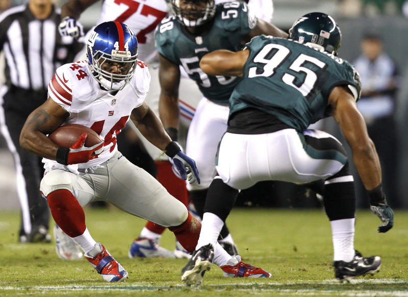 New York Giants running back Ahmad Bradshaw (44) rushes with the ball as Philadelphia Eagles linebacker Mychal Kendricks (95) defends during the first half of an NFL football game, Sunday, Sept. 30, 2012, in Philadelphia. (AP Photo/Mel Evans)