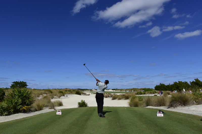 Tiger Woods hits from the third tee during the first round of the Hero World Challenge at the Albany Golf Club in Nassau, Bahamas, Thursday, Nov. 29, 2018. Woods now is No. 13 in the world as he hosts this holiday tournament for the 20th time. (AP Photo/Dante Carrer)