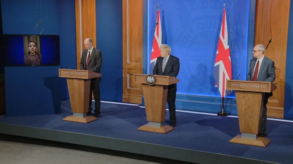 <p>Boris Johnson (centre) hosts a press conference with advisers</p> (PA)