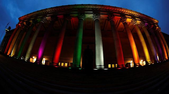 <p>St Georges Hall is illuminated with a rainbow flag following a vigil in memory of the victims of the gay nightclub mass shooting in Orlando, in Liverpool, northern England , June 13, 2016. REUTERS/Phil Noble </p>