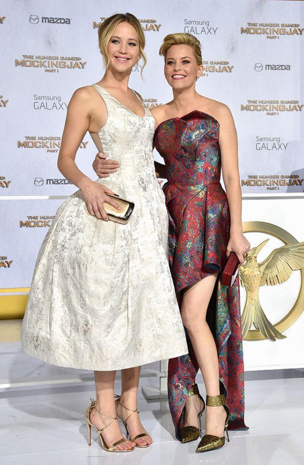 <p>Lawrence and Elizabeth Banks smile at the Los Angeles premiere of the first installment of <i>Mockingjay</i> on Nov. 17, 2014. (Photo: Getty Images) </p>