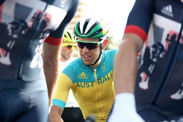Australia's Richie Porte (C) awaits the start of the men's road race in the Rio 2016 Olympic Games in Rio de Janeiro on August 6, 2016 (AFP Photo/Bryn Lennon)