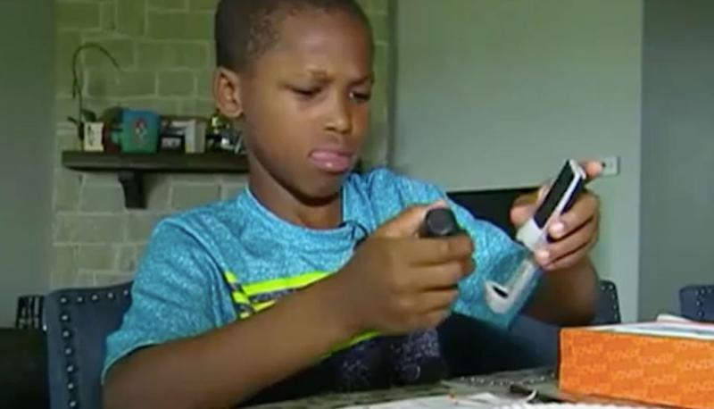 Bishop Curry, 11, invented a hot car warning alarm after hearing about a baby who had died in a hot car. Source: 7 News