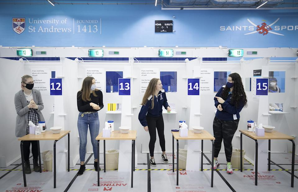 Students get a Covid-19 test at a mass testing centre set up at the sports centre at St Andrews University, ahead of the Christmas holiday. (Photo by Jane Barlow/PA Images via Getty Images)