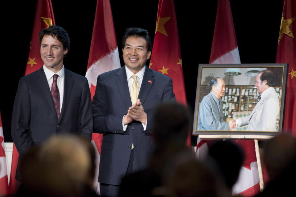 Prime Minister Justin Trudeau stands with China's Ambassador to Canada Luo Zhaohui after being presented a photo of his father, former prime minister Pierre Elliot Trudeau, meeting Chairman Mao Zedong, during a celebration of 45 years of Canada-China diplomatic relations, in Ottawa on Jan. 27, 2016. THE CANADIAN PRESS/Justin Tang