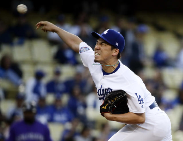 Los Angeles Dodgers starting pitcher Kenta Maeda, of Japan, throws against the Colorado Rockies during the first inning of a baseball game in Los Angeles, Wednesday, May 23, 2018. (AP Photo/Chris Carlson)
