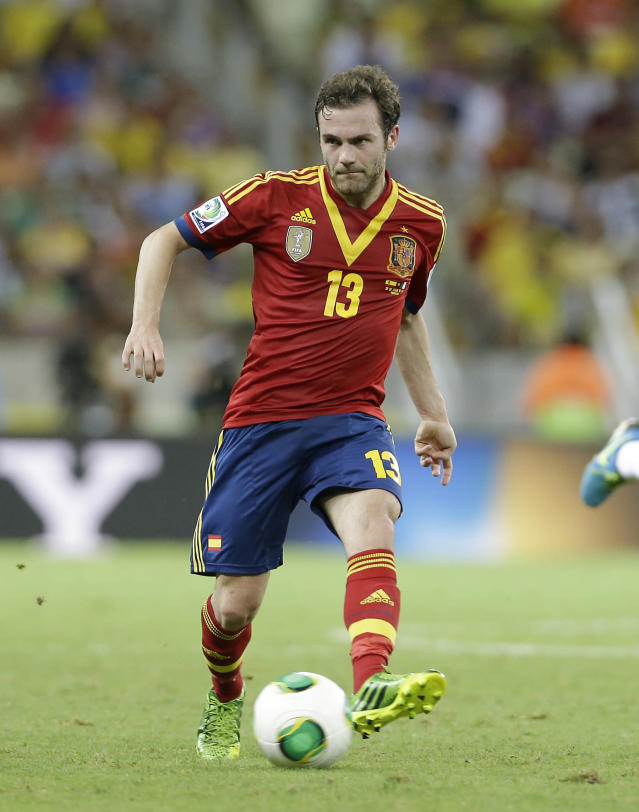 Spain's Juan Mata kicks the ball during the soccer Confederations Cup semifinal match between Spain and Italy at Castelao stadium in Fortaleza, Brazil, Thursday, June 27, 2013. (AP Photo/Antonio Calanni)