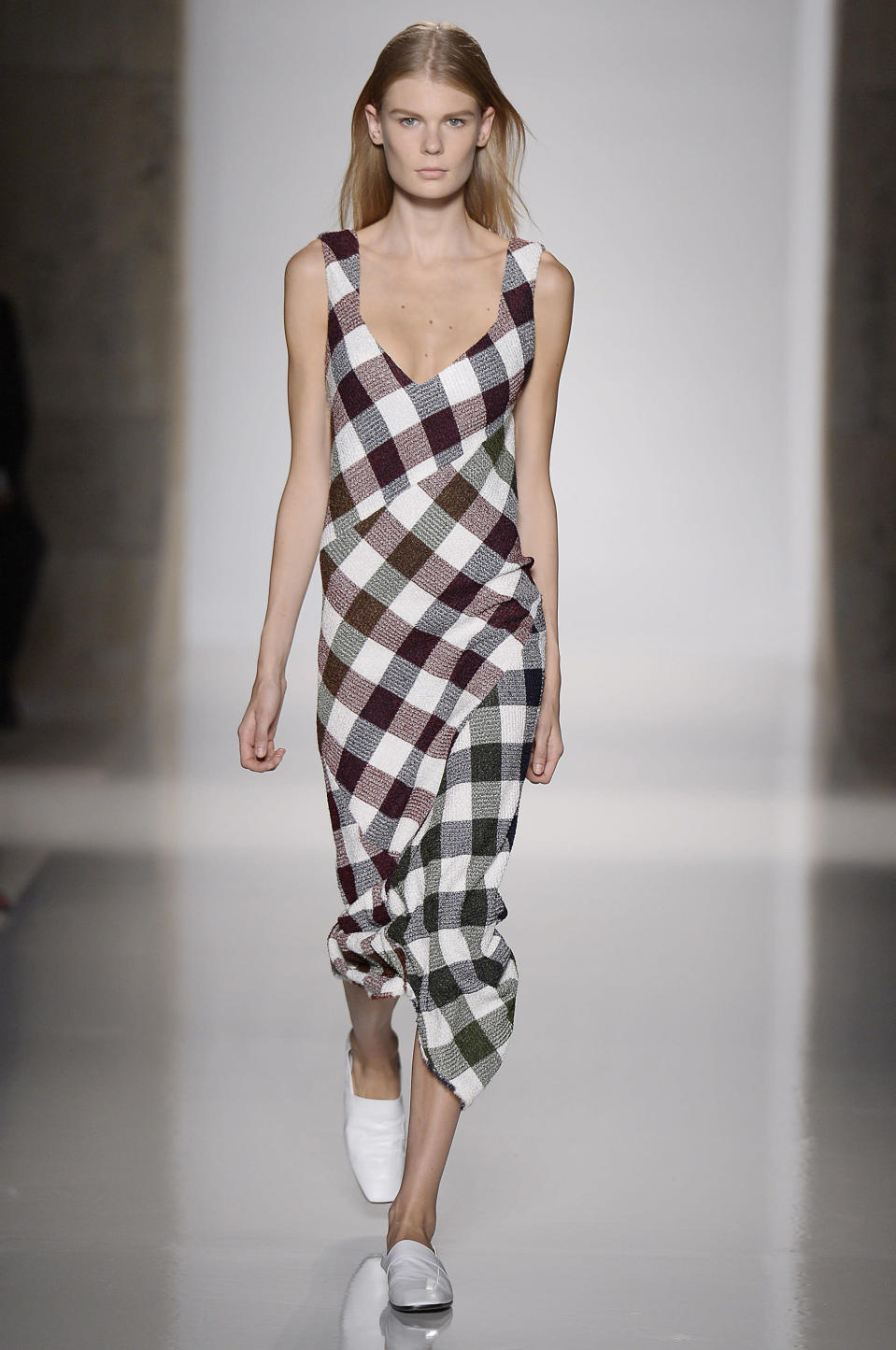 <p>A far cry from Beckham's now-famous noughties style, models were clad in a oversized checks (and oversized looks) for her SS16 show. Gone were heels in favour of white mannish mules while structured suits took the place of her once go-to dresses. <em>[Photo: Getty]</em> </p>