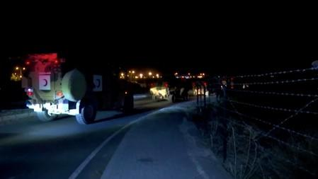 A Turkish armored military convoy is seen driving along the border with Syria, in Akcakale, Turkey