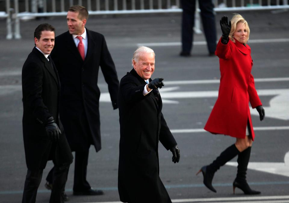 Vice President Joe Biden, with sons Hunter Biden and Beau Biden, and second lady Jill Biden, walk down Pennsylvania Avenue during the inaugural parade for President Barack Obama, Jan. 20, 2009, in Washington.