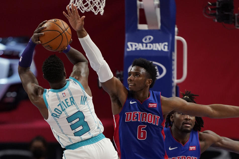 Charlotte Hornets guard Terry Rozier (3) shoots over the defense of Detroit Pistons guard Hamidou Diallo (6) during the second half of an NBA basketball game, Tuesday, May 4, 2021, in Detroit. (AP Photo/Carlos Osorio)