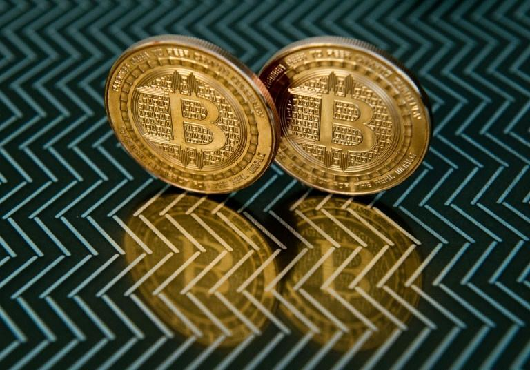 Coinbase makes market debut amid cryptocurrency frenzy