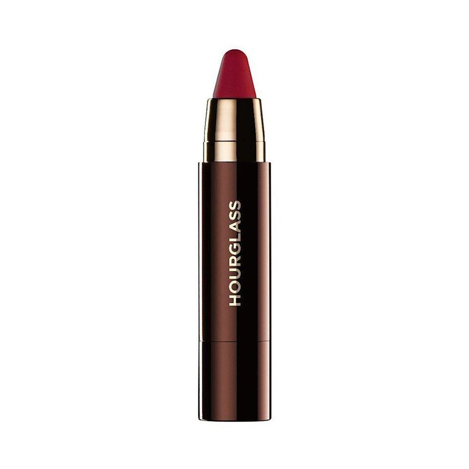 """<p><strong>Hourglass </strong></p><p>ulta.com</p><p><strong>$34.00</strong></p><p><a href=""""https://go.redirectingat.com?id=74968X1596630&url=https%3A%2F%2Fwww.ulta.com%2Fgirl-lip-stylo%3FproductId%3Dpimprod2020461&sref=https%3A%2F%2Fwww.elle.com%2Fbeauty%2Fmakeup-skin-care%2Fg36232213%2Flipstick-for-dark-skin-tones%2F"""" rel=""""nofollow noopener"""" target=""""_blank"""" data-ylk=""""slk:Shop Now"""" class=""""link rapid-noclick-resp"""">Shop Now</a></p><p>It can be hard to figure out which shades of pink work best on dark skin. Some can be too bright and look chalky, while others look dull. This soft pink from Hourglass is the perfect balance of bright and deep, not to mention the addition of shea butter makes it equal parts nourishing and vivid.</p>"""