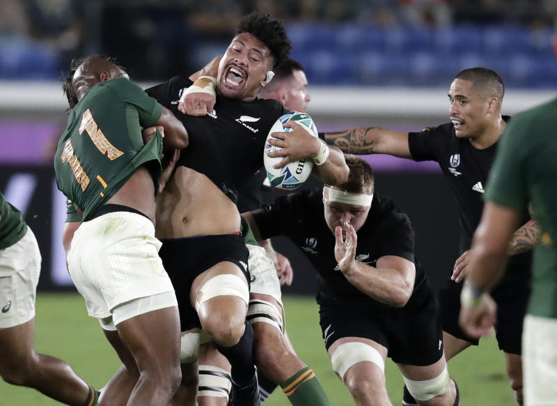 New Zealand's Ardie Savea reacts as he is tackled by South Africa's Makazole Mapimpi, left, during the Rugby World Cup Pool B game at International Stadium between New Zealand and South Africa in Yokohama, Japan, Saturday, Sept. 21, 2019. (AP Photo/Jae Hong)