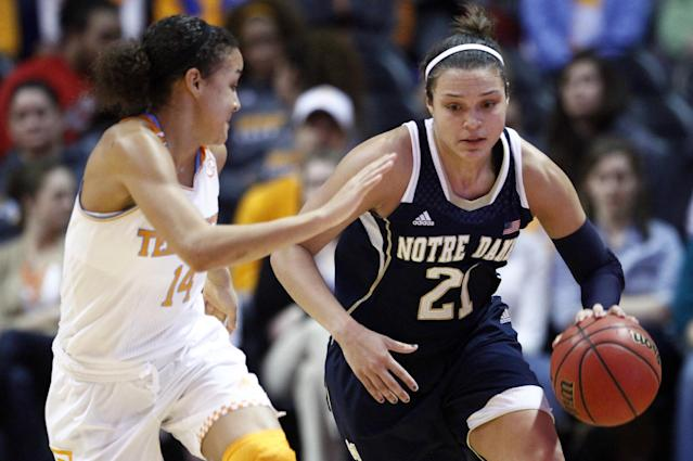 Notre Dame guard Kayla McBride (21) drives against Tennessee guard Andraya Carter (14) in the second half of an NCAA college basketball game Monday, Jan. 20, 2014, in Knoxville, Tenn. Notre Dame won 86-70. (AP Photo/Wade Payne)